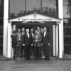 David Gill (4th left) welcomes David Jenkins (4th right) and the Milner team to SJIC